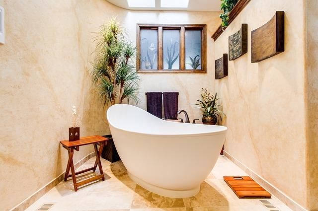 A bathroom decorated with plants.